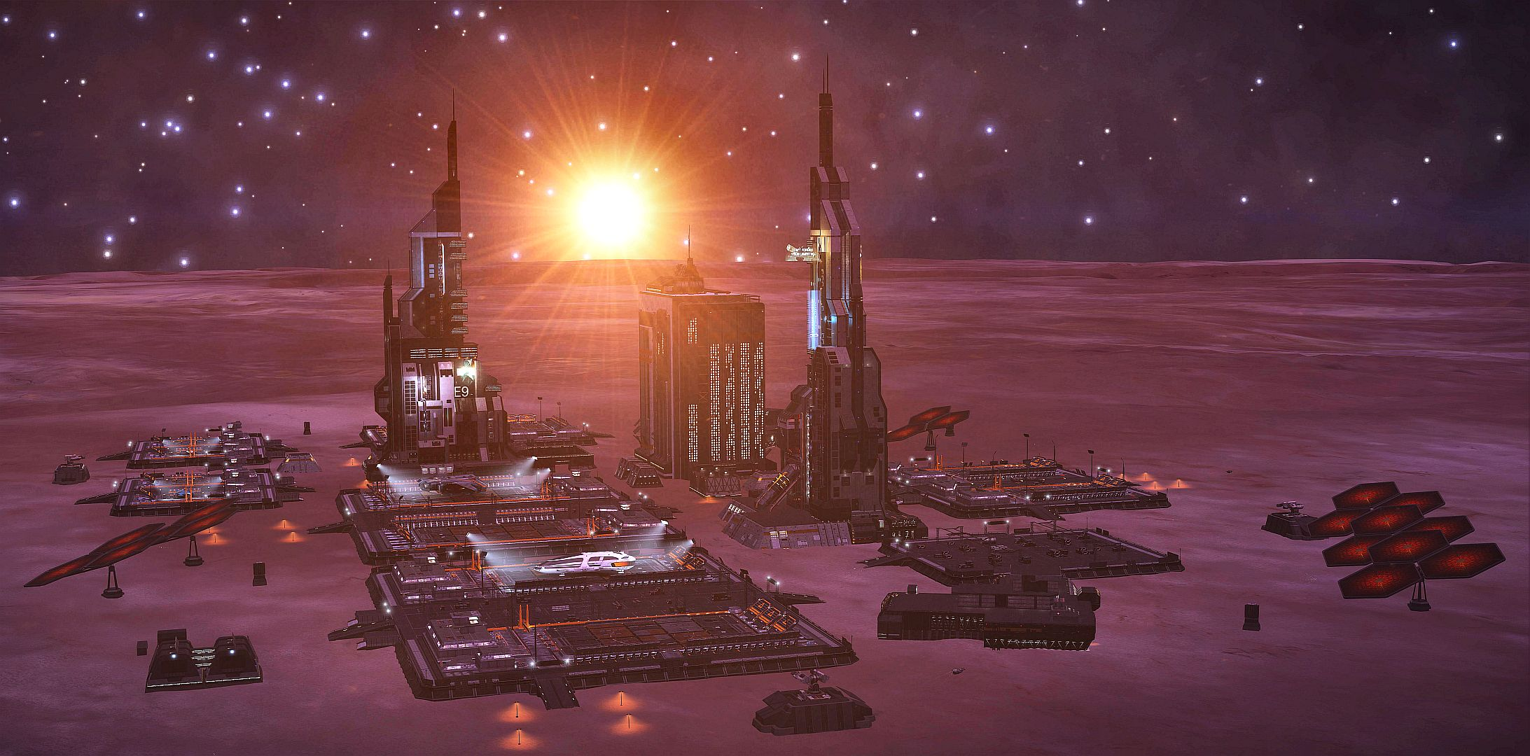 Soleil couchant sur la station planétaire Hipparque dans le système Pythéas.